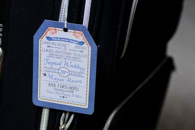 blue luggage tag invite with string