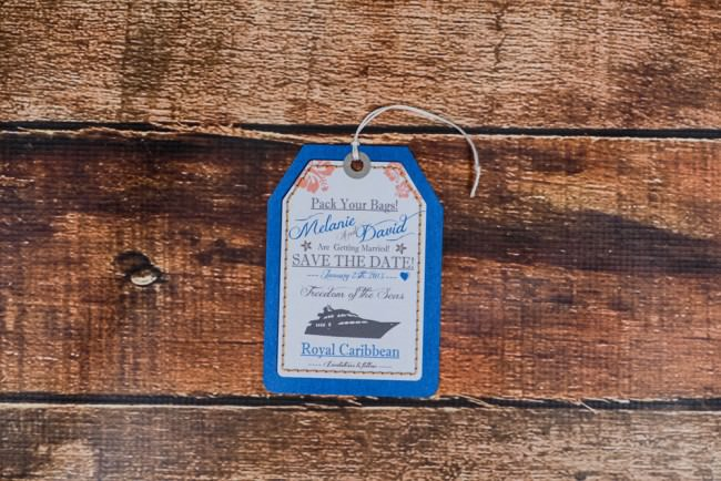 top view of luggage tag save the date with string