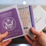 Purple passport & RSVP boarding pass