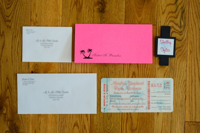 top view invite package in peach and teal