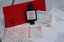 Red boarding pass wedding invites to Dreams Villamagna Resort, Mexico