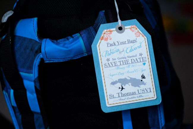 luggage tag invite hanging on bag
