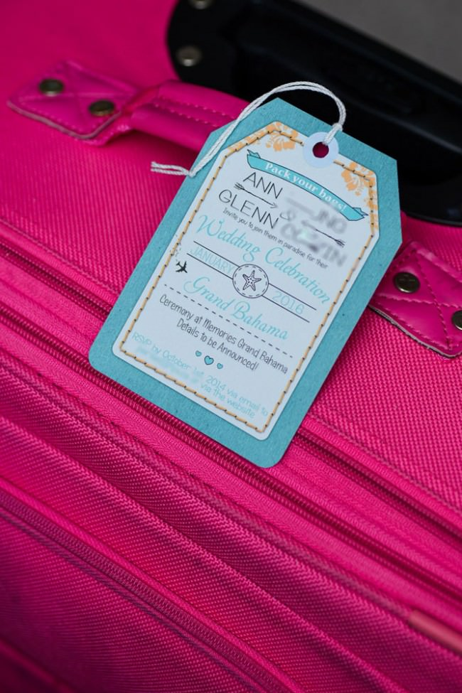 luggage tag with string on a pink suitcase