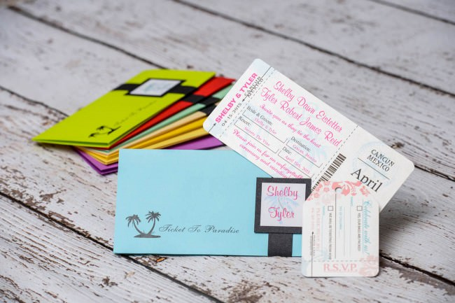 Blue boarding pass wedding invitation with a custom ticket and rsvp luggage tag