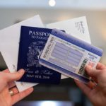 passport boarding pass and printed envelopes
