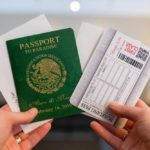 green passport w boarding pass RSVP